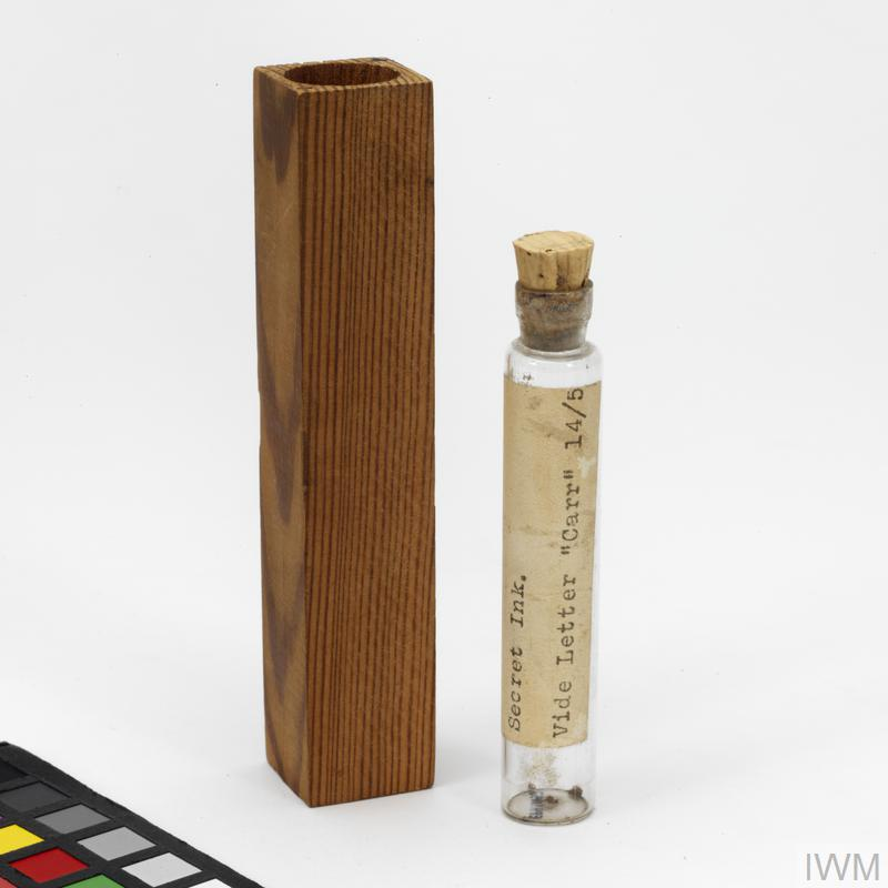 Invisible inks hidden in a bottle, with wooden casing.