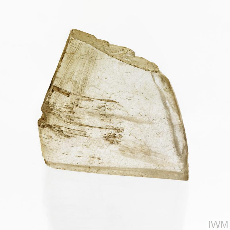 A thick irregular-shaped perspex fragment.