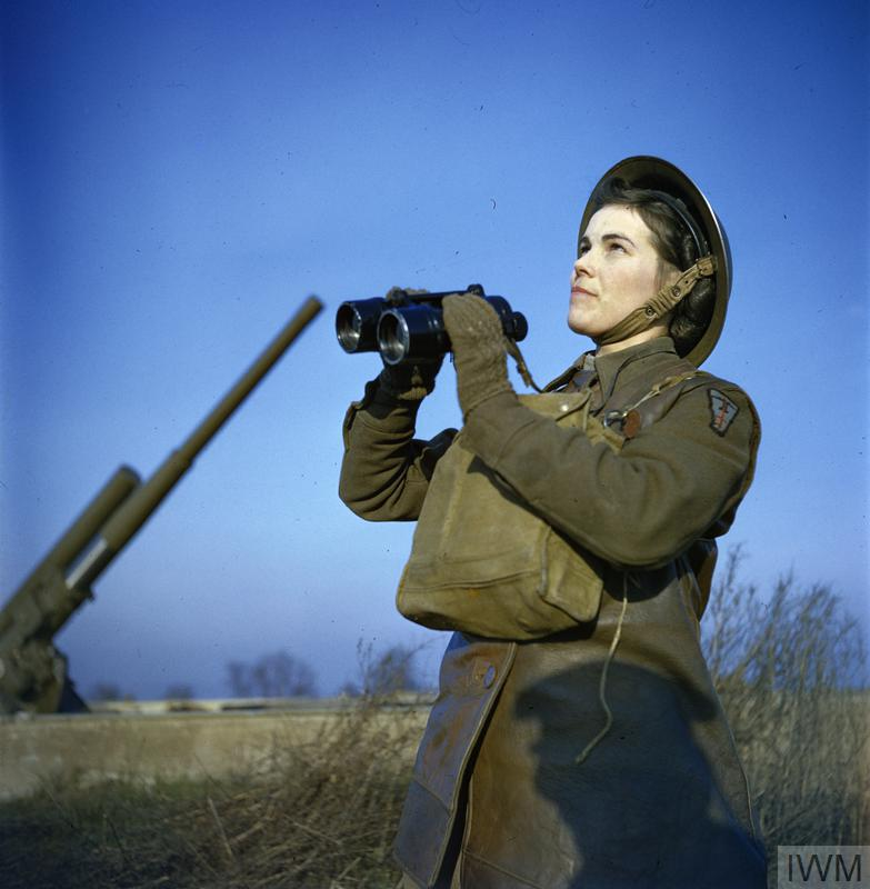 An Auxiliary Territorial Service (ATS) spotter with binoculars at an anti-aircraft command post.
