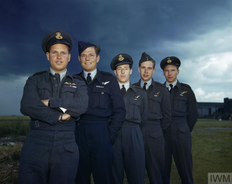 Wing Commander Guy Gibson with members of his crew. Left to right: Wing Commander Guy Gibson, VC, DSO and Bar, DFC and Bar; Pilot Officer P M Spafford, bomb aimer; Flight Lieutenant R E G Hutchinson, wireless operator; Pilot Officer G A Deering and Flying Officer H T Taerum, gunners.