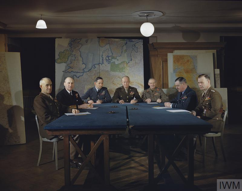 Lt General Omar Bradley, Commander in Chief, 1st US Army; Admiral Sir Bertram H Ramsay, Allied Naval Commander in Chief, Expeditionary Force; Air Chief Marshal Sir Arthur W Tedder, Deputy Supreme Commander, Expeditionary Force; General Dwight D Eisenhower, Supreme Commander, Expeditionary Force; General Sir Bernard Montgomery, Commander in Chief 21st Army Group; Air Chief Marshal Sir Trafford Leigh-Mallory, Allied Air Commander, Expeditionary Force; and Lt General Walter Bedell-Smith.