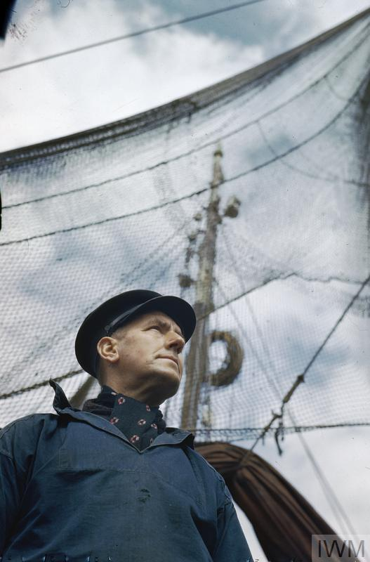 BELGIAN FISHERMEN IN THE BRITISH FISHING VILLAGE OF BRIXHAM, DEVON IN 1944