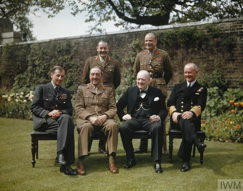 Seated, left to right: Air Chief Marshal Sir Charles Portal; Field Marshal Sir Alan Brooke, the Rt Hon Winston Churchill; Admiral Sir Andrew Cunningham. Standing, left to right: the Secretary to the Chiefs of Staffs Committee, Major General L C Hollis; and the Chief of Staff to the Minister of Defence, General Sir Hastings Ismay.