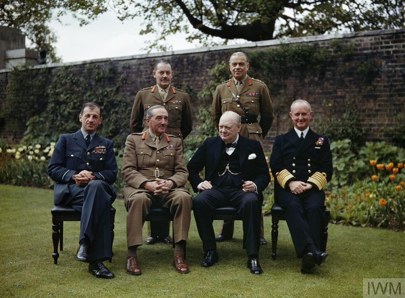 THE PRIME MINISTER, THE RT HON WINSTON CHURCHILL, WITH HIS CHIEFS OF STAFF IN THE GARDEN OF NO 10 DOWNING STREET, LONDON, 7 MAY 1945