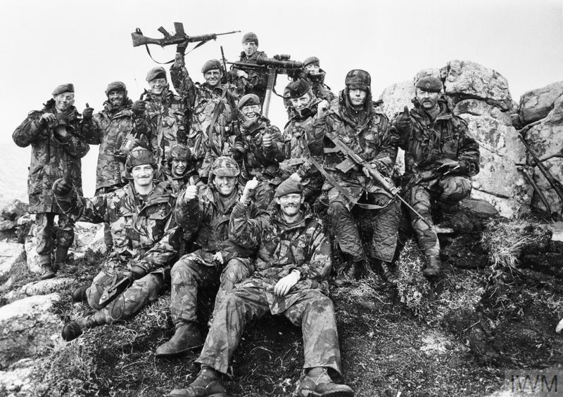 7 Platoon, G Company, 2nd Battalion Scots Guards on Mount Tumbledown celebrate the news of the Argentine surrender at dawn on 14 June 1982.