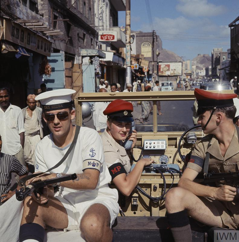 A British combined services police patrol in Crater, Aden. Lance Corporal Vivienne McCoy of 28 Independent Company, Women's Royal Army Corps with Leading Patrolman James Field, Royal Navy and Lance Corporal Shawn Westrip, Royal Military Police.