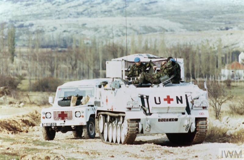 A British FV432 and a Landrover both equipped for medical duties with UNPROFOR in the Vitez area of Bosnia. Both vehicles are painted in the high visibility white colour scheme adopted by UNPROFOR vehicles in Bosnia.