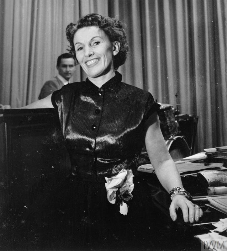 Lale Andersen, the singer who achieved popularity during the Second World War with the song 'Lilli Marlene' , takes a break during a concert in the Musikhalle organised by the British Forces Radio Network BFN Hamburg.