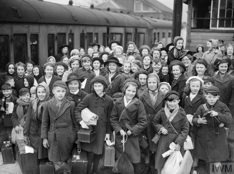 Some of the 175 children being monitored by the Ministry of Health during their evacuation from Bristol to the Kingsbridge area of Devon. The photograph was taken on arrival at Brent Station.