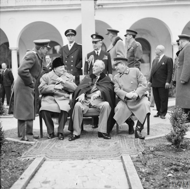 Wartime Conferences of the 'Big Three': The 'Big Three' at Yalta. From left to right: Prime Minister Winston Churchill, President Franklin Roosevelt and Marshal Josef Stalin in the grounds of Livadia Palace, Yalta.