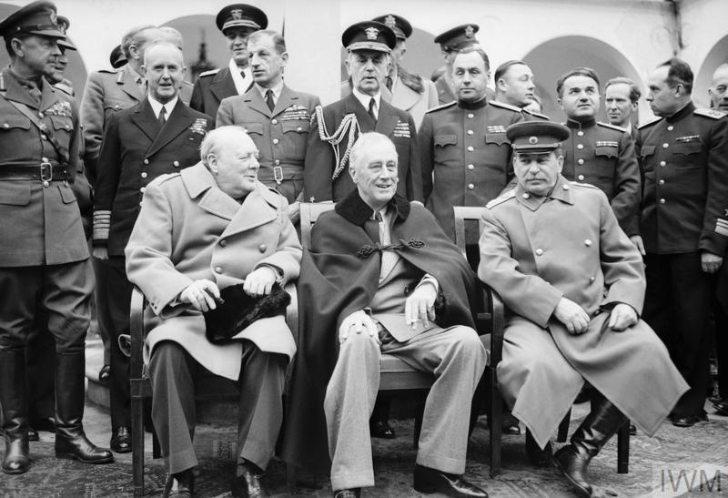 Winston Churchill, Franklin D Roosevelt and Jospeh Stalin sit for photographs during the Yalta ('Big Three') Conference in February 1945.
