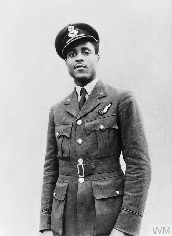 Half-length portrait of Pilot Officer J H Smythe RAFVR of Sierra Leone, a newly-qualified navigator, photographed while undergoing training at No 11 Operational Training Unit, Westcott, Buckinghamshire, England.