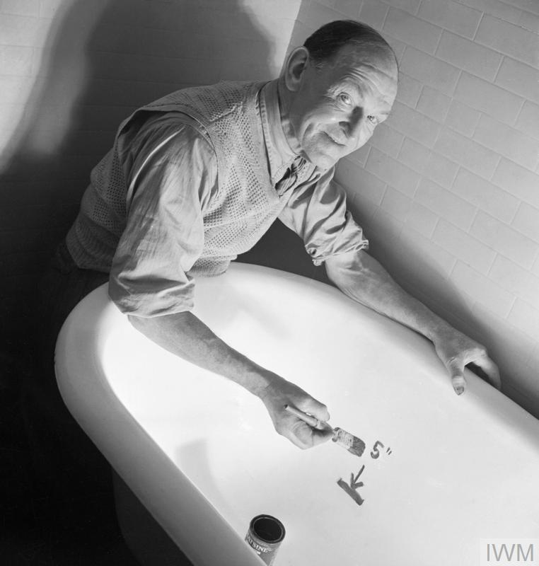 A man demonstrates how to draw a line in the bath