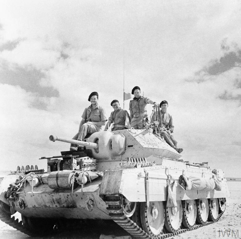 A Crusader tank (christened 'Vidi') of the 4th Light Armoured Brigade in the Western Desert, 20 September 1942. Crew L-R: Louis Léonard; Jean-Paul Sarcelet; Roger Deschamps; Marc Logez. All were members of the Free French Flying Column No. 1.