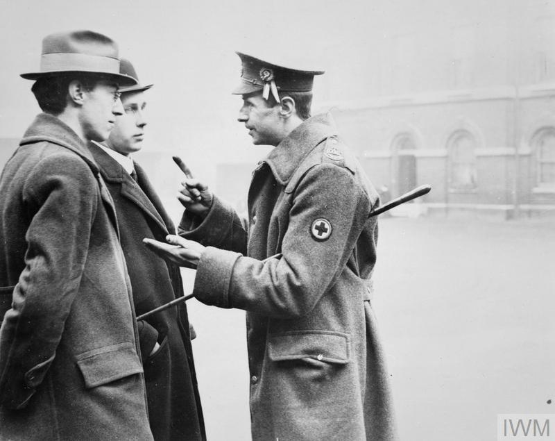 The Recruiting Sergeant of the Royal Army Medical Corps giving instructions.