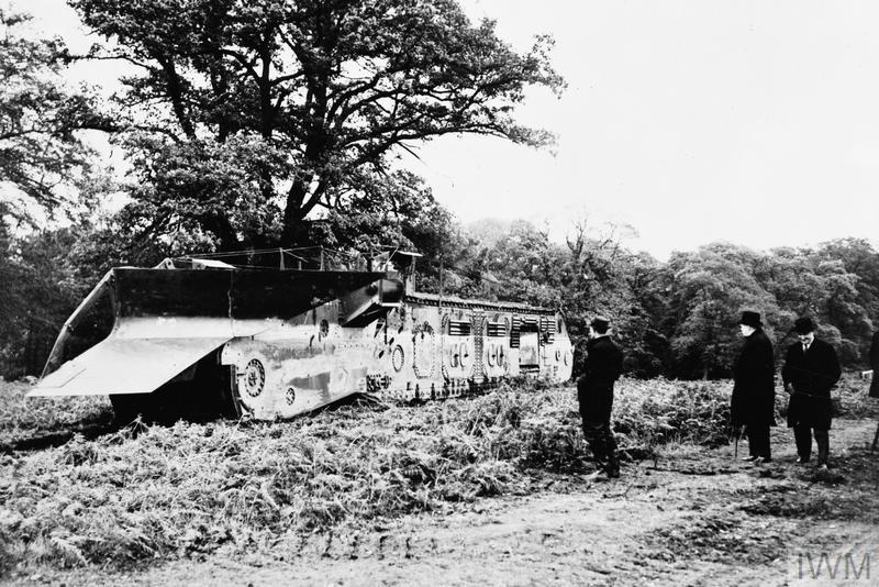 A view of the Land Excavating Trenching machine being inspected by Winston Churchill at Clumber Park, Nottingham. The machine was otherwise known as ' White Rabbit No. 6', 'Cultivator No. 6' or 'Nellie'.