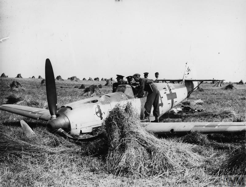 Messerschmitt Bf 109E of 2./JG 52, flown by Unteroffizier Zaunbrecher, resting in a wheat field after being shot down during a combat over Hastings, 12 August 1940.