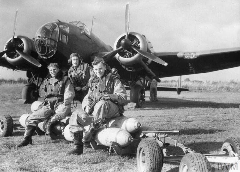 Handley Page Hampden of No. 83 Squadron with crew, seated on a loaded bomb trolley at Scampton, 2 October 1940.
