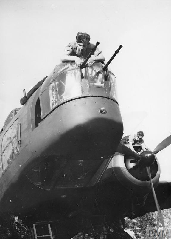 An airmen working on the front turret of a Wellington bomber, 9 September 1940.