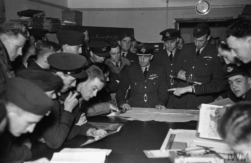Wellington crews studying maps at a briefing with the station commander, 2 September 1940.