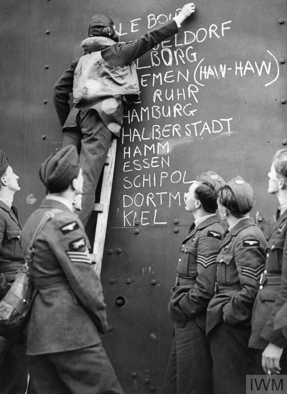 Blenheim crews of No. 110 Squadron at Wattisham add Le Bourget to a list of recent targets, August 1940.