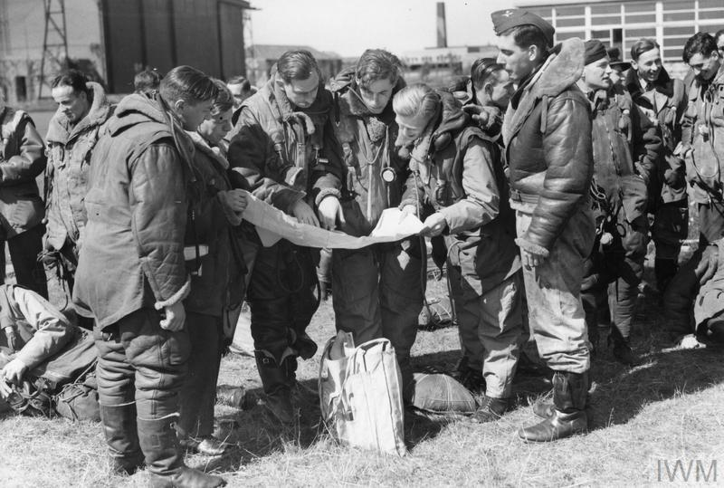 Wellington bomber crews photographed at a press event after the first raid on Berlin, which took place on the night of 25/26 August 1940.