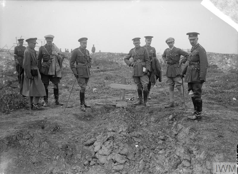 King George V with Edward, Prince of Wales, General Henry Rawlinson, the Commander of the Fourth Army, and Lieutenant-General Walter Norris Congreve, the Commander of the 13th Corps, and other Staff officers at the grave of an unknown British soldier near Fricourt, 10th August 1916.