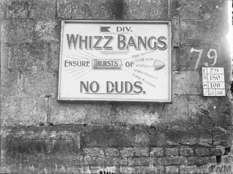 """A signboard in Fonquevillers advertising the 5th Division """"Whizz Bangs"""" Concert Party, December 1916. Notice also the board giving particulars of the billeting capacity of the building."""