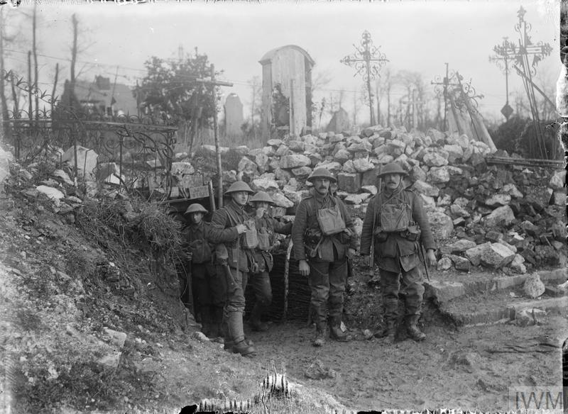 British troops at the entrance to a bomb store in the Churchyard at Foncquevillers, March 1917.