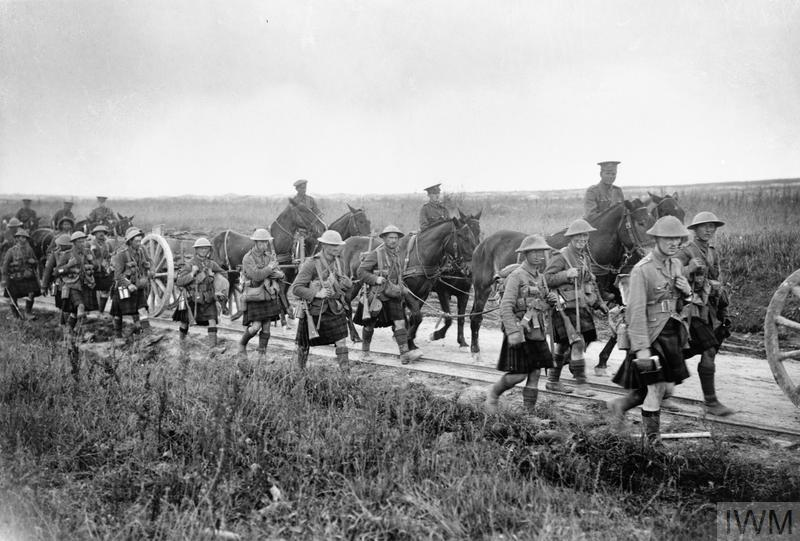 Troops of the Gordon Highlanders and ammunition limbers moving up to the forward area on the Albert - Bapaume road, near La Boisselle, July 1916.