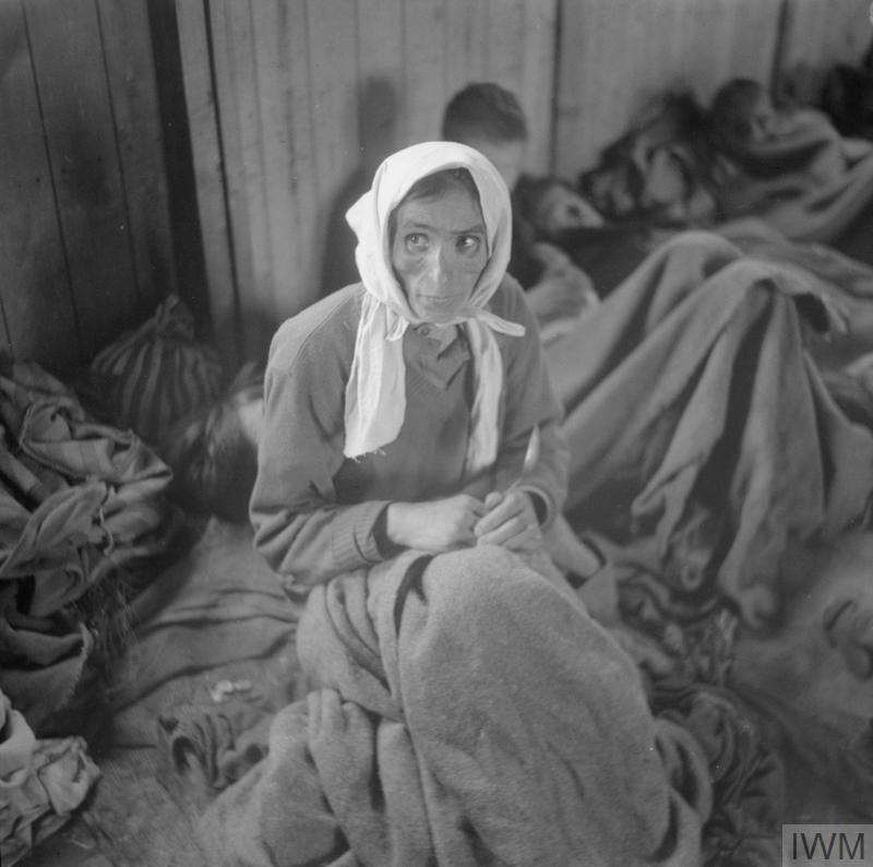 A woman inmate suffering from typhus in one of the camp huts.