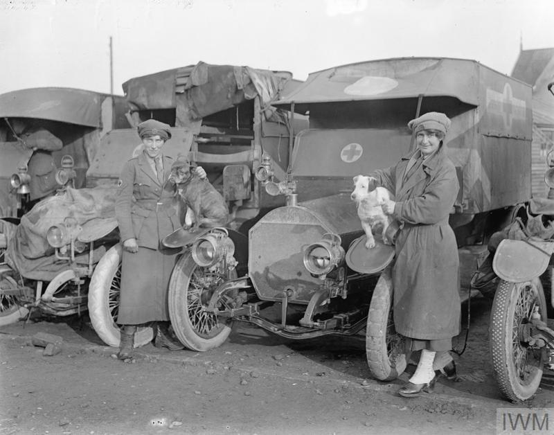 Miss Lawson and Miss Heesman, of the First Aid Nursing Yeomanry, with their dogs and ambulances in Calais, January 1917.