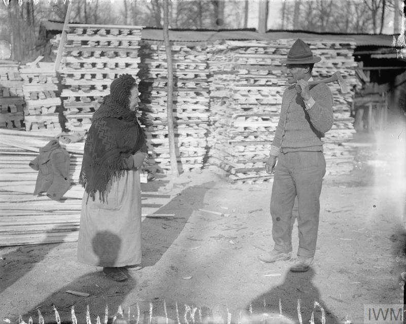 A Maori lumber worker talking to a Frenchwoman. Forest de Nieppe, March 1917