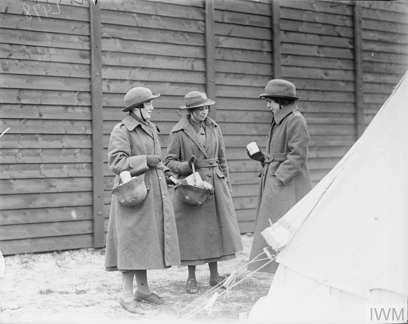 WAACs with their tinned rations in German steel helmets at Etaples, 26 April 1918.