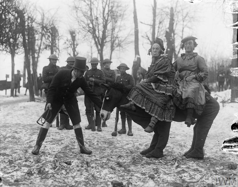 "Troops from the Royal Flying Corps Kite and Balloon Section rehearsing the pantomine ""Cinderella""at Bapaume, 2 January 1918."