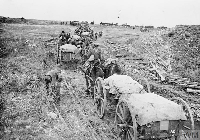 Battle of the Canal du Nord. Supply limbers going up over newly-won ground, near Moeuvres, 28th September 1918. Note the wrecked light railways.