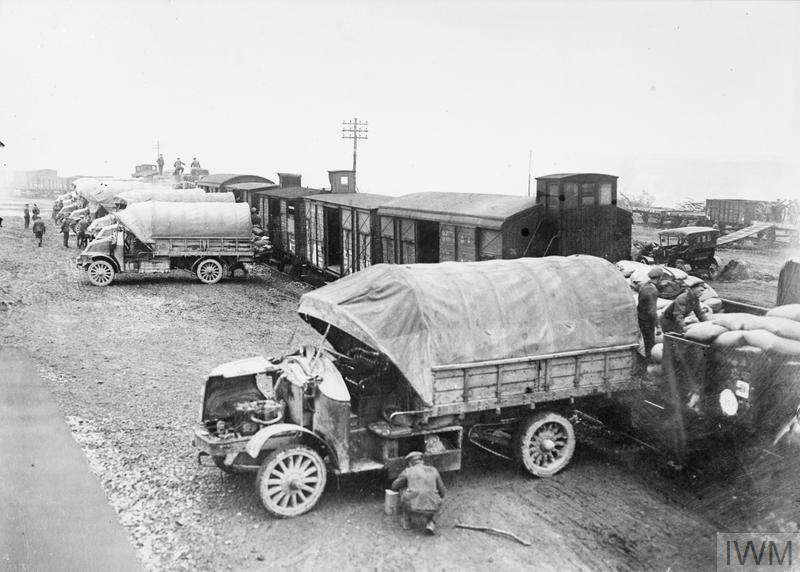 Ration Supply. Lorries unloading a supply train at railhead to deliver to a forward refilling point.