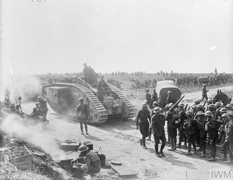Battle traffic seen at Grevillers on 25 August 1918, following the village's capture by the British 37th Division and the New Zealand Division at the start of the Hundred Days Offensive, a few days earlier. Mark V tanks of the 10th Battalion the Tank Corps and British and New Zealand infantry going forward. Also seen are captured German 4.2 inch guns etc.
