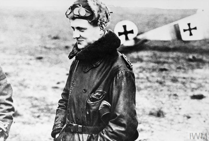 Manfred von Richthofen, wearing a leather coat, fur cap and goggles, photographed after landing from a combat flight.