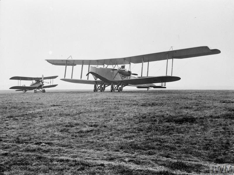 A First World War biplane, the Handley Page O/100 with another biplane, the Royal Aircraft Factory SE.5 alongside.