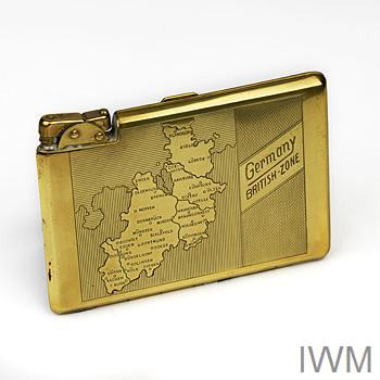 Cigarette case and lighter engraved with a map of the British zone of occupied Germany.
