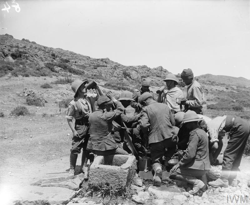Men of the 9th Battalion, Sherwood Foresters (Nottinghamshire and Derbyshire Regiment) filling their bottles and mess tins at a well sunk by the Royal Engineers, Gallipoli, August 1915.