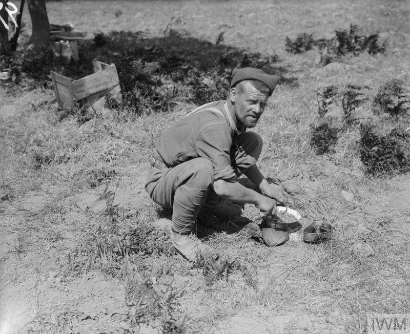 A soldier preparing a meal in a rest camp, possibly at Cape Helles