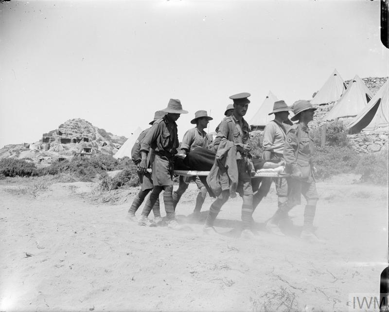 Australians carrying wounded back from the firing line.