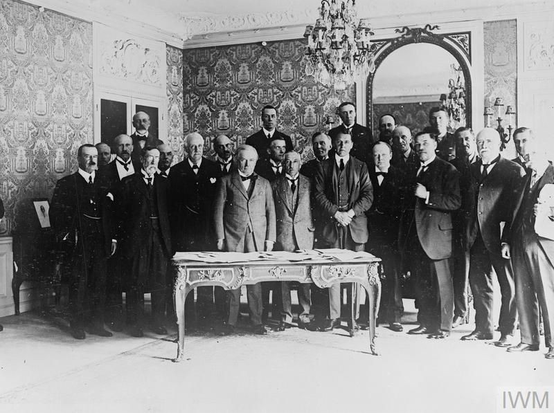 Historic group taken after the deliberations of the British Empire Delegation at the Premier's house in Rue Nitot, Paris, at which the most momentous decisions were arrived. Left to right: Sir Joseph Ward, General Smuts, Lord Milner, Sir Joseph Cook, Mr Barnes, Mr Balfour, Mr Montague, Mr Lloyd George, Mr A Chamberlain, Mr Hughes, Sir F Smith, Mr Winston Churchnill, General Sir Henry Wilson, Mr Botha, Mr Massey and Mr Kerr.