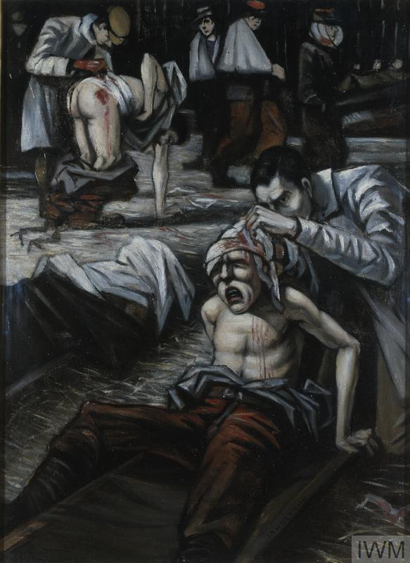 Doctors and medical orderlies are treating injured soldiers in an open building with straw on the floor. One patient, stripped to the waist, is sitting up on a stretcher while a doctor inspects a loosely dressed wound to his head. Next to him a body lies on a stretcher the face covered in bandages. Behind, a patient is crouching on all fours with his trousers round his ankles, while a doctor inspects a wound in his lower back. Two other French soldiers stand by with arms in slings.