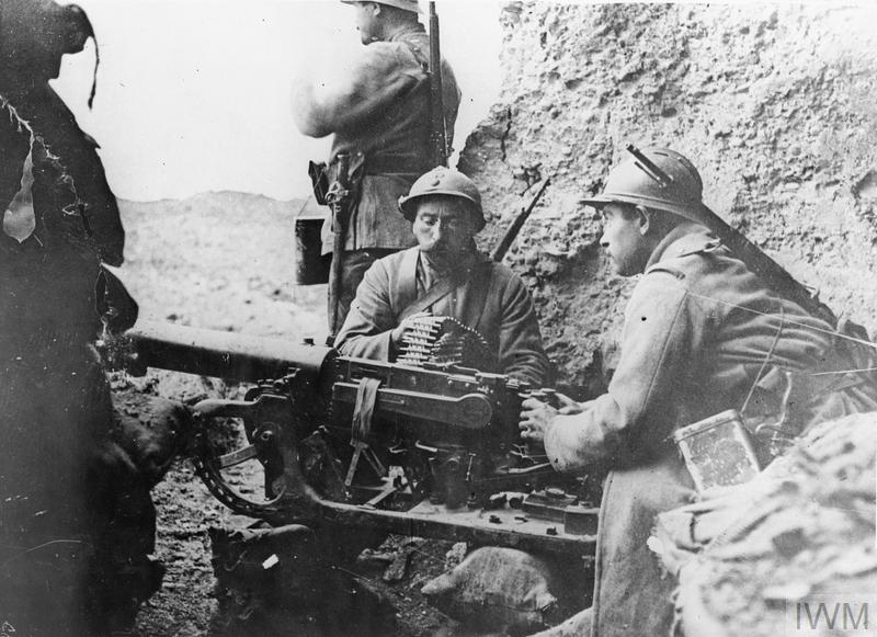 French troops manning a captured German Maxim gun at Fort Douaumont, Verdun, 1916.