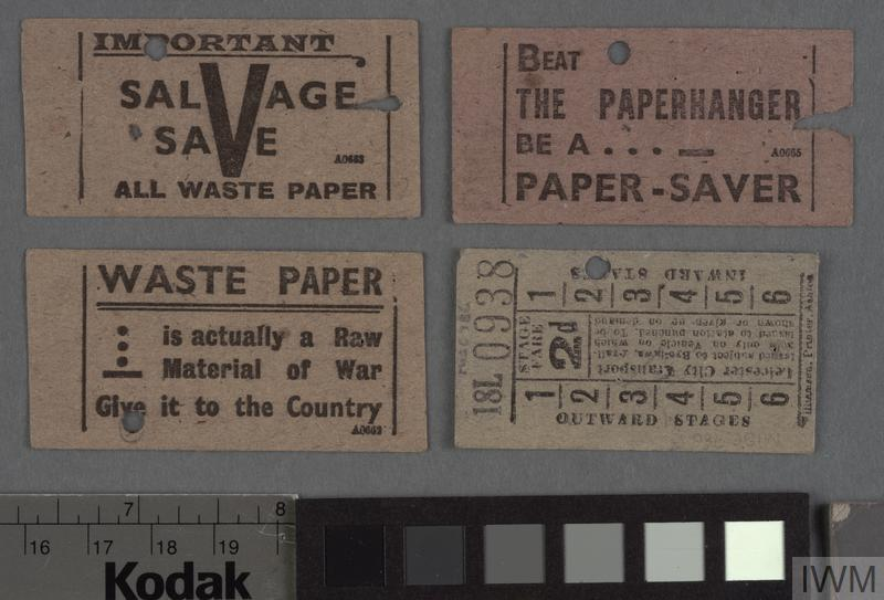 Second World War Air Raid Precautions gas mask card and three bus tickets bearing the war-time slogan 'Beat the paper hanger be a paper-saver'.