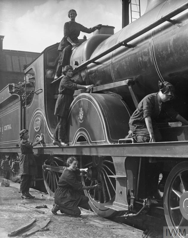 Female railway workers cleaning locomotives on the Great Central Railway, Birmingham, September, 1918.