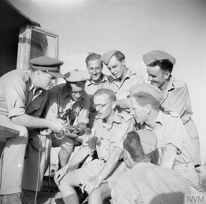 Richard Dimbleby interviewing members of the Army Film and Photograph Unit (AFPU) in North Africa in June 1942